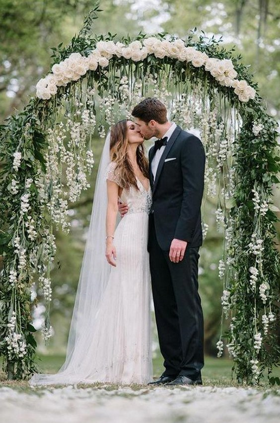 wedding-arbor-with-hanging-flowers-and-a-row-of-white-rosebuds